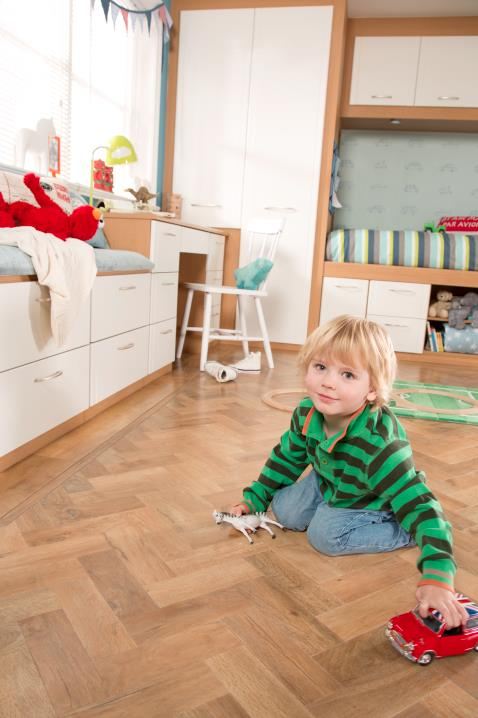 toddler on floor_sharps